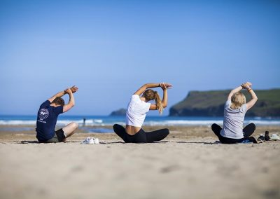 Beach yoga with Wavehunters Fitness