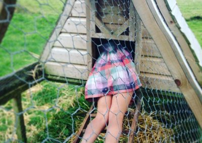 Ella in a hen house