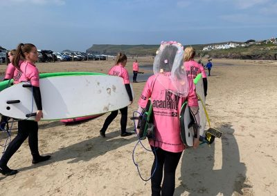 Hen party surf lesson at Polzeath beach with Wavehunters