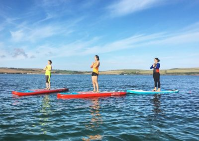 SUP yoga with Wavehunters Fitness